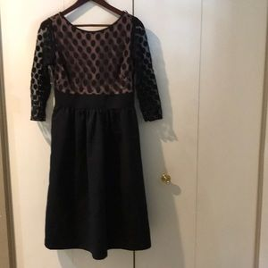 Black tool dress with polka dots